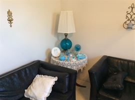 Wall sconces, corner round table & matching set of lamps with sofa & chair.