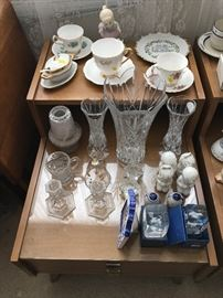 Misc vintage cups and saucers.  Glassware on more mahogany side tables