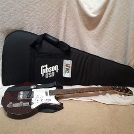 Dark Burgundy Lyon LI38 by Washburn telecaster style guitar signed by Mike Kennerty (All American Rejects).