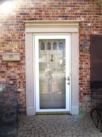 Beveled glass storm door