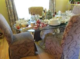 Very nice looking glass top table with 4 chairs