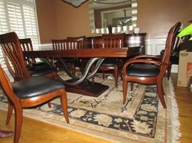 beautiful table with metal detail work, oriental rug Bernhardt