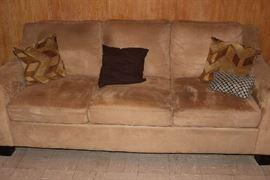 Like-new modern taupe sofa.