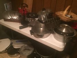 pots and pans including one Magnalite pot and a whole box of Magnalite lids