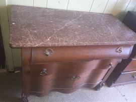 several marble top tables