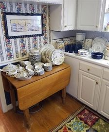 Oak Drop Leaf Kitchen Table and China set for 12 in a Dogwood Pattern
