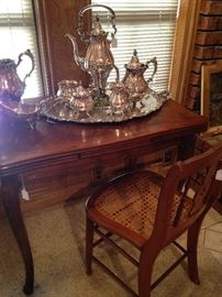Baroque coffee service by Wallace; drawleaf table; antique cane chair