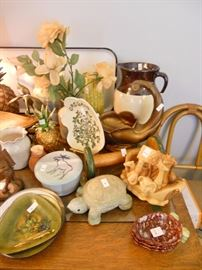 Many pieces of handmade pottery and other collectibles