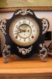 Ansonia metal clock with porcelain face