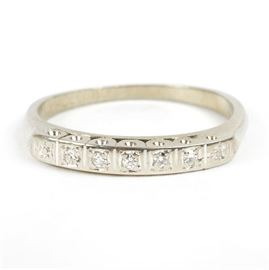 18K White Gold Diamond Band: An 18K white gold diamond band. This women's ring features bright-cut set diamonds in an 18K white gold shank and squared shoulders.