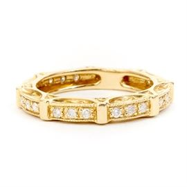 Diamond and 14K Yellow Gold Decorated Ring: A 14K yellow gold ring, featuring sections of three round diamonds set between bars of gold, with trellis accent around the sides of the ring.