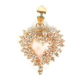 14K Yellow Gold Diamond Heart Pendant: A 14K yellow gold pendant with round diamonds basket set in a cluster around the edges of the open heart.