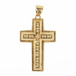 10K Yellow Gold Cross Pendant: A 10K yellow gold cross pendant. This 10K yellow gold cross pendant features etched floral accents along the raised body with rope twist edge and central starburst accent. The back of the pendant is pierced with a repeating cross pattern.