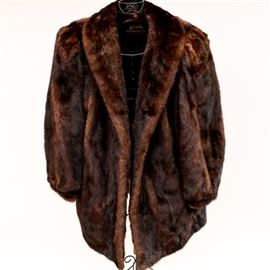 Koslow's Mink Fur Coat: A women's fur coat. The group features a genuine mink fur collared coat crafted by Koslow's with the manufacturer's tag sewn to the interior.
