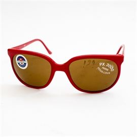 """Vuarnet France PX2000 Sunglasses: A pair of Vuarnet France PX2000 sunglasses. This pair features a vibrant red frame with mustard yellow lenses. The pair is marked """"Vuarnet"""" with their signature emblem and includes retail stickers on the lenses."""