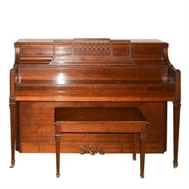 Yamaha Upright Piano and Bench: A Yamaha upright piano, serial number 893829, produced at the company's Hamamatsu, Japan, factory in 1969. Features include a walnut finish and Federal style design, with fluted tapered legs ending in brass casters. The piano comes with a matching bench.