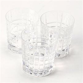 "Set of Tiffany & Co. ""Plaid"" Crystal Glasses: A set of Tiffany & Co. Plaid crystal glasses. These three double Old Fashioned glasses feature vertical and horizontal cuts. The pieces are marked to the bottom ""Tiffany & Co""."