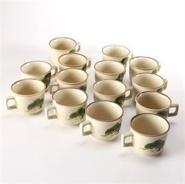 "Hand-Painted Japanese Mikasa ""Pine Branch"" Cups: A set of Japanese Mikasa Pine Branch cups. There are fourteen matching Mikasa cups with handles and hand-painted green and brown pine branches. The pieces are marked to the underside ""Mikasa Flower Arrangements Pine Branch 00804 Made in Japan""."
