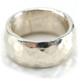 "Men's Sterling Silver Hammered Ring: A men's sterling silver hammered ring, size 10. The ring is marked ""Gusterman"" on the interior. The total approximate weight is 0.58 ozt."
