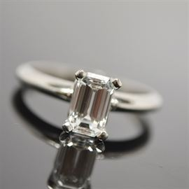 Platinum 1.06 Cts Diamond Solitaire Ring With GIA Certificate: A platinum 1.06 ctw diamond solitaire ring with GIA certificate #11807963. This emerald cut diamond is set in a basket head on a rounded profile shank.