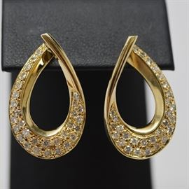 Bideas 14K Yellow Gold Diamond Dangle Pierced Earrings: A pair of 14K yellow gold diamond dangle pierced earrings by Bideas. Earrings feature a diamond embellished arched design, with a pierced push back post.