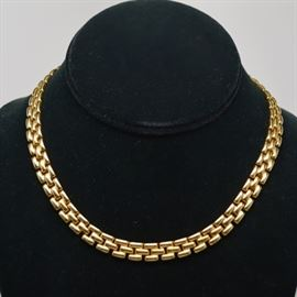 14K Yellow Gold Panther Chain Necklace: A 14K yellow gold panther chain necklace. Chain features a paver design with a flat back, and is secured with a hidden box table an figure eight safety.