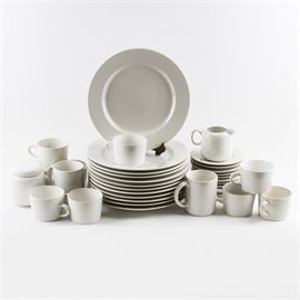 "White Stoneware Set: A set of white stoneware. The set of thirty-six includes twelve dinner plates, eleven saucers, a lidded sugar bowl, creamer, nine teacups, and two coffee mugs. Some pieces are marked ""Stoneware Japan,"" ""Signature,"" and others are unmarked to the underside."