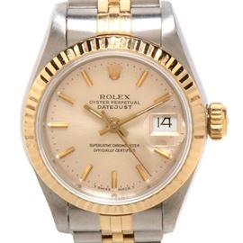 Women's Rolex Datejust 18K Gold and Steel Silver Dial Automatic: A women's Rolex Datejust 18K yellow gold and stainless steel silver dial automatic wristwatch.