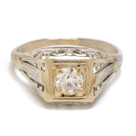 Early 20th Century 18K White Gold Diamond Filigree Ring: An early 20th century 18K white gold diamond filigree ring.
