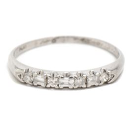 Platinum and Diamond Band: A platinum and diamond band with 0.23 ctw in diamonds.