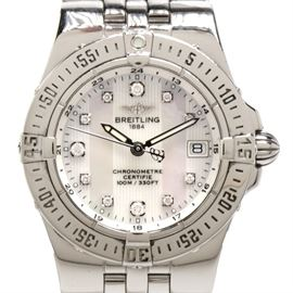 Women's Breitling Starliner Date MOP Diamonds Steel Quartz Watch: A Women's Breitling Starliner date mother of pearl and diamonds stainless steel quartz wristwatch. Includes Breitling box, hang tag and papers.