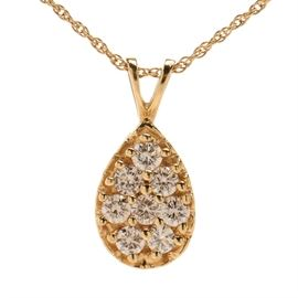 14K Yellow Gold Diamond Pendant Necklace: A 14K yellow gold diamond pendant link necklace with tear drop pendant comprised of 0.64 ctw in diamonds with split bale.