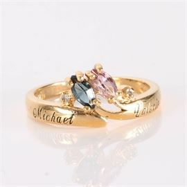 Diamond and Sterling Silver Ring with Colored Stones: A gold plated sterling silver ring with diamonds and colored stones.