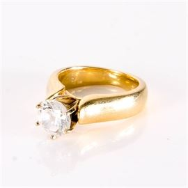 14k Gold Solitaire Ring: A 14K yellow gold ring with a colorless stone.