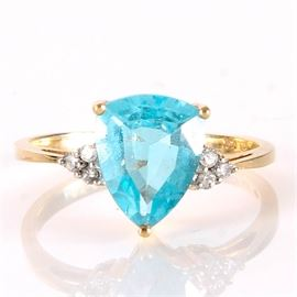 10K Gold Ring with Diamonds and Topaz: A 10K yellow gold ring with stones.