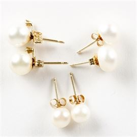 14K Gold Pearl and Diamond Earring Collection: A collection of gold and pearl earrings. The collection includes three pairs of gold and pearl stud earrings. One pair has pearls and diamonds; the other pairs have pearls.