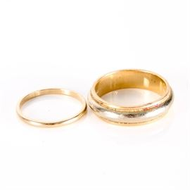 Pair of 14K Gold Band Rings: A pair of yellow gold band rings. The pair includes one 1.80 mm band ring, and a 6.00 mm band ring with both yellow and white gold.