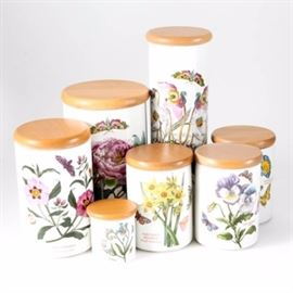 """Portmeirion """"Botanic Gardens"""" Ceramic Canisters: A collection of seven Portmeirion lidded kitchen canisters. The canisters all have round shapes, in different heights. All have round wooden lids, and all feature colorful floral and insect designs to the sides. The items are all marked """"Portmeirion""""."""