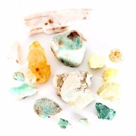 Blue and Yellow Mineral Specimens: A collection of blue and yellow mineral specimens. Featuring several varieties of stones and minerals in aqua, green, pink, yellow and gold. The green stones included are thought to be soapstone.