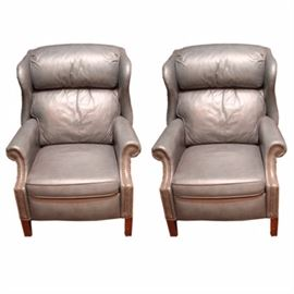 Pair of Blue Leather Reclining Chairs: A pair of blue leather reclining chairs. Both of the chairs features a light blue upholstery, gold tone tufting pins, a removable seat cushion, and wooden Marlborough legs. There are no visible makers markings or labels on these chairs.
