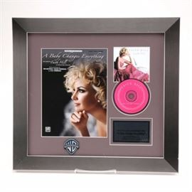 "Faith Hill Framed Award Presentation: A framed award of Faith Hill's ""#1 adult contemporary song 'A Baby Changes Everything'_. Presented in a silver tone frame and under glass are sheet music for the song, a CD cover, and a copy of the CD. The Warner Brothers Records logo is present to the bottom. A wire is present to the verso for display."