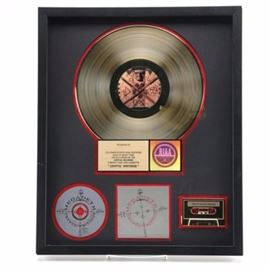 "Megadeth Gold Record ""Cryptic Writings"": A Megadeth Gold Record Cryptic Writings. This gold record award was presented to commemorate certified sales of more than 500,000 copies. It has the Megadeth Cryptic Writings gold album and cassette with the RIAA certification plate. The award is matted in black and trimmed under glass with a black custom frame and a hanging wire is attached to the verso."