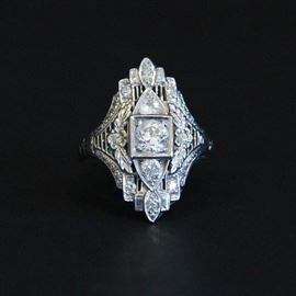 Antique 14K White Gold and Diamond Ring: An antique 14K white gold and diamond ring.