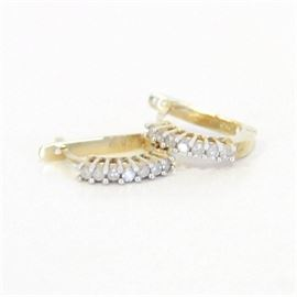 10K Yellow Gold and Diamond Earrings: A 10K yellow gold and diamond earrings.