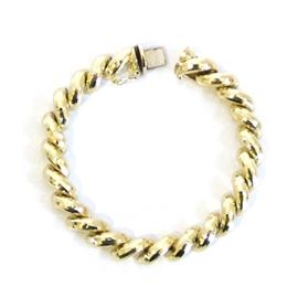 14K Yellow Gold Bracelet: A 14K yellow gold bracelet.