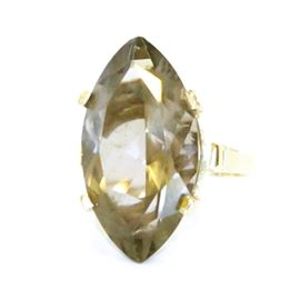 14K Yellow Gold and Smoky Quartz Ring: A 14K yellow gold and marquis cut smoky quartz ring.