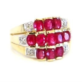10K Yellow Gold, Ruby and Diamond Ring: A 10K yellow gold, ruby, and diamond ring.