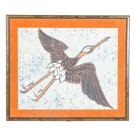 Original Signed Batik: An original signed Batik. This fabric artwork depicts a crane and is signed by the artist Davidson near the bottom. Presented with burnt orange colored matting, under glass, and in a brown and black finished wooden frame which is ready to hang via a wire hanger on the verso.