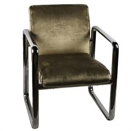 Mid Century Modern Chair: A Mid-Century Modern side chair, after the style of Milo Baughman. The chair rests on a bent aluminum frame with a polished chrome finish. The chair is upholstered in luxurious tan suede with matching piping on each side.