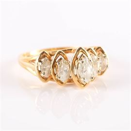 14K Five Stone Diamond Marquise Ring: A 14K yellow gold five stone diamond marquise ring.